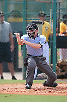 Umpire Junior Valentine calls a strike during an Instructional League game between the Philadelphia Phillies and Pittsburgh Pirates at Pirate City on October 11, 2011 in Bradenton, Florida.  (Mike Janes/Four Seam Images)