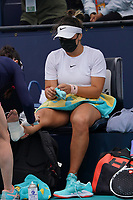 3rd April 2021; Miami Gardens, Miami, Florida, USA;   Bianca Andreescu receives medical attention during the women's finals of the Miami Open on April 3, 2021, at Hard Rock Stadium in Miami Gardens, Florida.