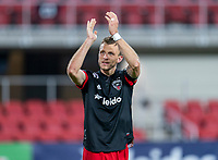 WASHINGTON, DC - APRIL 17: Frederic Brillant #13 of D.C. United salutes the crowd after a game between New York City FC and D.C. United at Audi Field on April 17, 2021 in Washington, DC.