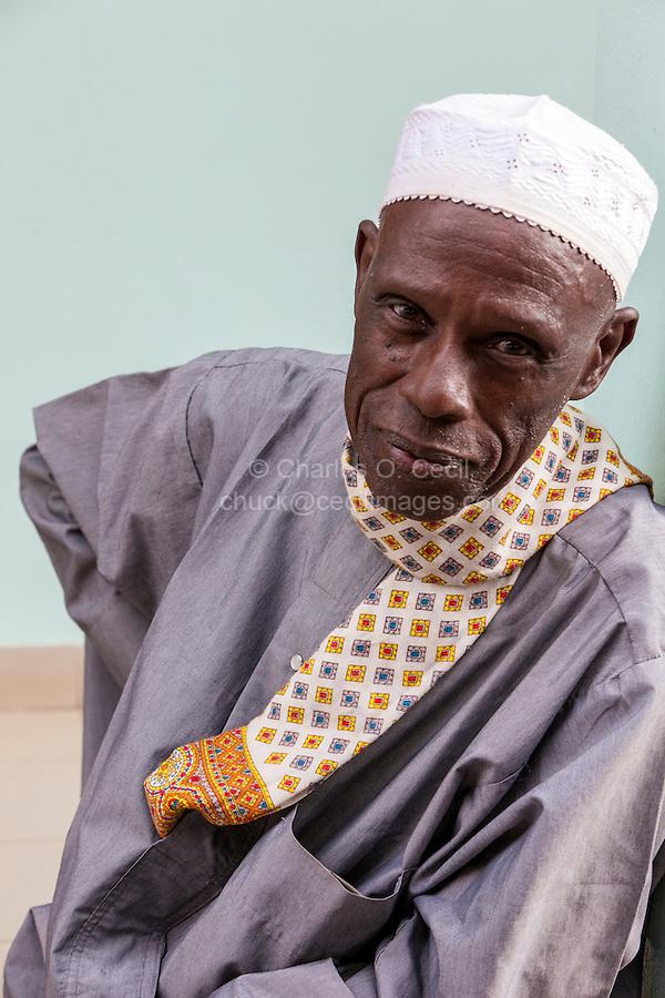 Senegal, Saint Louis.  Senegalese Muslim Man Waiting for Prayer Time at the Mosque.