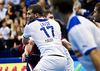 02 NOV 2011 - LONDON, GBR - Britain's Chris Mohr (#07 - blue and red) finds his way to goal blocked by the Israeli defence during the Men's 2013 World Handball Championship qualification match at the National Sports Centre at Crystal Palace .(PHOTO (C) NIGEL FARROW)