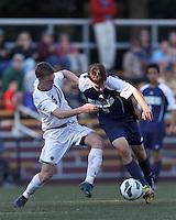 University of Rhode Island (URI) forward Jamie Eckmayer (9) on the attack as Boston College midfielder Jason Abbott (6) defends. Boston College defeated University of Rhode Island, 4-2, at Newton Campus Field, September 25, 2012.