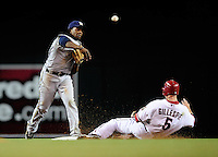 May 7, 2010; Phoenix, AZ, USA; Arizona Diamondbacks base runner Cole Gillespie slides into the game ending double play as Milwaukee Brewers second baseman Rickie Weeks throws to first to end the game at Chase Field. The Brewers defeated the Diamondbacks 3-2. Mandatory Credit: Mark J. Rebilas-