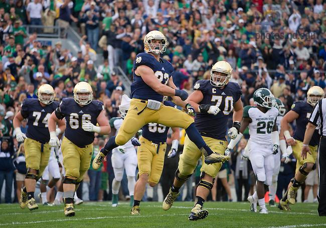 Sept. 21, 2013; Cam McDaniel (33) celebrates a touchdown against Michigan State.<br /> <br /> Photo by Matt Cashore