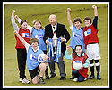 24/02/2009  Copyright Pic: James Stewart.File Name : sct_jspa09_scottis_cup.FORMER FALKIRK LEGEND ALEX TOTTEN SHOWS OFF THE HOMECOMING SCOTLAND SCOTTISH CUP TO (l to r rear) REBECCCA LEWIS, SARAH JOHNSTON, IAN MCARTHUR, ROSS ANDERSON (l to r front) STUART IRVINE AND CAITLIN MUNGALL, PRIMARY SEVEN PUPILS AT ST MARGARET'S PRIMARY SCHOOL, POLMONT......Press Release..... A unique interactive tour to engage primary school children with football and the Homecoming Scottish Cup rolls into town today, Tuesday 24 February 2009 at St Margaret's Primary School in Falkirk.  . .Up to 100 pupils in primaries 5 to 7 at each local school will receive specialist skills and drill training from Scottish Football Association coaches as well as getting the chance to view the Homecoming Scottish Cup trophy itself.. .The school tour takes the form of a giant 'football-shaped' tent, which houses the world's oldest footballing trophy and information about Homecoming Scotland and the Scottish Cup tournament.. .Future football stars will be given soccer skills training ahead of watching their home team, Falkirk, take on Inverness Caledonian Thistle in the quarter finals of the Homecoming Scottish Cup on the weekend of 7 March.. .Falkirk legend Alex Totten, who used to manage the side, will be on hand at St Margaret's Primary School to share his knowledge and experience with the kids and to see the trophy himself.. .All primary schools in Scotland will also be sent education packs to encourage pupils to know more about Homecoming Scotland and to learn more about healthy eating, fitness and playing football as a way to keep fit and have fun.  . .As part of the football celebrations, the tour will then encourage locals in the town centre to get behind their local team, when the cup visits The Mall in Falkirk later in the afternoon.. .The Homecoming Scottish Cup Tour has been designed to engage with Scotland's local communities and spread the message about joining in the celebrations for Homecomi