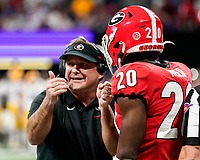 ATLANTA, GA - DECEMBER 7: head coach Kirby Smart of the Georgia Bulldogs confers with J.R. Reed during a game between Georgia Bulldogs and LSU Tigers at Mercedes Benz Stadium on December 7, 2019 in Atlanta, Georgia.
