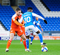 Peterborough United's Siriki Dembele under pressure from Blackpool's Oliver Turton<br /> <br /> Photographer Chris Vaughan/CameraSport<br /> <br /> The EFL Sky Bet League One - Peterborough United v Blackpool - Saturday 21st November 2020 - London Road Stadium - Peterborough<br /> <br /> World Copyright © 2020 CameraSport. All rights reserved. 43 Linden Ave. Countesthorpe. Leicester. England. LE8 5PG - Tel: +44 (0) 116 277 4147 - admin@camerasport.com - www.camerasport.com