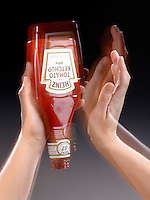 OVERCOMING THE INERTIA OF KETCHUP<br /> Hitting The Side Of The Upturned Bottle<br /> The ketchup at the bottom of the bottle is at rest and remains at rest as the bottle rebounds upward in response to the blow. This use of Newton's first law separates the ketchup from the bottle.