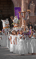 Young ANGELS leave TEMPLO DEL ORATORIO DE SAN FELIPE NERI during EASTER PROCESSION - SAN MIGUEL DE ALLENDE, MEXICO .