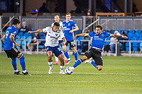 SAN JOSE, CA - MAY 01: Edison Flores #10 of DC United is tackled by Eric Remedi #5 of the San Jose Earthquakes during a game between San Jose Earthquakes and D.C. United at PayPal Park on May 01, 2021 in San Jose, California.