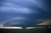 A wide view of a tornadic supercell thunderstorm with major tornado raging across the prairies north of Aberdeen South Dakota. This storm produced a family of more than 6 tornadoes during the evening of June 23rd, 2002.