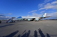 WEST PALM BEACH, FL - MARCH 08: US President Trump Visits Alabama Following Tornado Devastation and then flies to West Palm Beach. Seen here President Donald Trump fist pumps and waves along with his wife First Lady Melania Trump as they exit Air Force One and greet supporters at the Palm Beach International Airport on March 8, 2019 in West Palm Beach, Florida.<br /> <br /> <br /> People:  President Donald Trump, Melania Trump