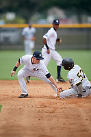 New York Yankees second baseman Nick Solak (2) tags Lolo Sanchez (57) out attempting to steal second base during an Instructional League game against the Pittsburgh Pirates on September 29, 2017 at the Yankees Minor League Complex in Tampa, Florida.  (Mike Janes/Four Seam Images)