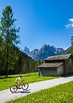 Italy, South Tyrol (Trentino - Alto Adige), near Sexten, district Moos: the picturesque Fischleintal (Val Fiscalina) at Drei Zinnen Nature Park (Parco Naturale Tre Cime), side valley of Sexten Valley (Valle di Sesto) - and Sexten Dolomites (Dolomiti di Sesto) La meridiana di Sesto with summits Zwoelferkofel (Cima Dodici) (left) and Einserkofel (Cima Una) (right) | Italien, Suedtirol, bei Sexten, Ortsteil Moos: das malerische Fischleintal im Naturpark Drei Zinnen - ein Nebental des Sextentals - vor den Gipfeln der Sextener Sonnenuhr mit dem Zwoelferkofel (links) und dem Einserkofel (rechts)