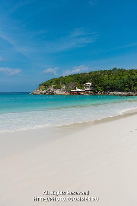 Surf line of white sand on idyllic Raya island, near Phuket, Thailand