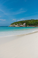 Surf line of white sand on idyllic Raya island, near Phuket, Thailand