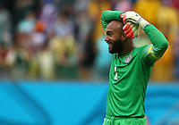 Tim Howard of USA reacts after a missed chance late on