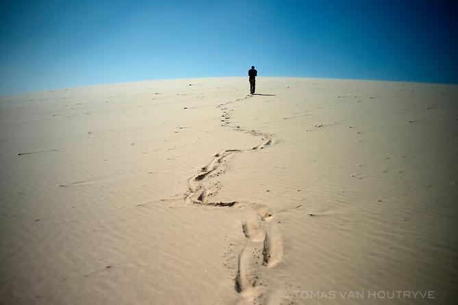 A guide walks through the Western Sahara desert near Dakhla, Morocco on Dec. 16, 2011.