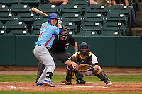Tennessee Smokies outfielder Billy McKinney (4) at bat in front of catcher Justin O'Conner and umpire Alex Ransom during a game against the Montgomery Biscuits on May 25, 2015 at Riverwalk Stadium in Montgomery, Alabama.  Tennessee defeated Montgomery 6-3 as the game was called after eight innings due to rain.  (Mike Janes/Four Seam Images)