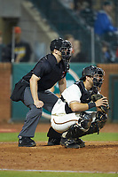 Home plate umpire Tanner Moore sets up behind Greensboro Grasshoppers catcher Zac Susi (45) during the game against the Hagerstown Suns at First National Bank Field on April 6, 2019 in Greensboro, North Carolina. The Suns defeated the Grasshoppers 6-5. (Brian Westerholt/Four Seam Images)