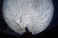 BNPS.co.uk (01202 558833)<br /> Picture: ZacharyCulpin/BNPS<br /> <br /> Pictured: A 20ft suspended replica of the moon by UK artist Luke Jerram is the centre piece in the exhibtion<br /> <br /> A slender loris can be seen stargazing as part of a new attraction at a British safari park showing off its nocturnal animals.<br /> <br /> The tiny 10ins long, 275 grams primate, which is native to India, has huge brown eyes to hunt insects in the dark.<br /> <br /> The creatures, which spend most of their lives in trees but can't jump, are endangered in the wild due to a loss of habitat and poaching.<br /> <br /> Longleat Safari Park in Wilts is looking after a male and female of the species in an indoor enclosure set against the backdrop of a 20ft suspended replica of the moon by UK artist Luke Jerram.