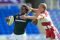 Marland Yarde of London Irish is high-tackled by Billy Twelvetrees of Gloucester Rugby during the Aviva Premiership match between London Irish and Gloucester Rugby at the Madejski Stadium on Saturday 8th September 2012 (Photo by Rob Munro)
