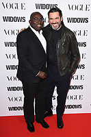 """Edward Enninful and Roland Mouret<br /> arriving for the """"Widows"""" special screening in association with Vogue at the Tate Modern, London<br /> <br /> ©Ash Knotek  D3457  31/10/2018"""