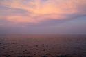 Spain - Barcelona - The sun sets over the mediterranean sea.