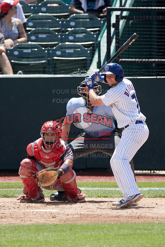 South Bend Cubs designated hitter P.J. Higgins (7), Peoria Chiefs catcher Jose Godoy (27), and umpire Andy Stukel wait for a pitch from pitcher Brennan Leitao (not shown) during the first game of a doubleheader on July 25, 2016 at Four Winds Field in South Bend, Indiana.  South Bend defeated Peoria 9-8.  (Mike Janes/Four Seam Images)