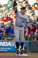 Omaha Storm Chasers first baseman Clint Robinson #25 stretches for a throw during the Pacific Coast League baseball game against the Round Rock Express on July 20, 2012 at the Dell Diamond in Round Rock, Texas. The Chasers defeated the Express 10-4. (Andrew Woolley/Four Seam Images).