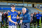 Cillian Burke Milltown receives the cup from Weeshie Lynch after defeating St Brendans College in the Dunloe Cup final in Fitzgerald Stadium on Wednesday
