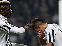 Juventus' Paulo Dybala, right, celebrates with teammate Paul Pogba after scoring the winning goal during the Italian Serie A football match between Juventus and Roma at Juventus Stadium. Juventus won 1-0.