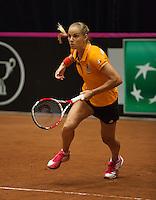 The Netherlands, Den Bosch, 16.04.2014. Fed Cup Netherlands-Japan, training, Arantxa Rus (NED)<br /> Photo:Tennisimages/Henk Koster