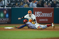 Greensboro Grasshoppers third baseman Patrick Dorrian (15) applies a tag to Juan Pascal (10) of the Hagerstown Suns as he slides into third base at First National Bank Field on April 6, 2019 in Greensboro, North Carolina. The Suns defeated the Grasshoppers 6-5. (Brian Westerholt/Four Seam Images)