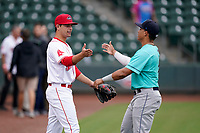 Second baseman Nick Yorke (4) of the Greenville Drive. left, greets JC Correa (11) of the Asheville Tourists bnefore a game on Tuesday, August 31, 2021, at Fluor Field at the West End in Greenville, South Carolina. (Tom Priddy/Four Seam Images)