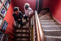 Magic students walk downstairs after class at the Cape Town College of Magic, which is housed in a historic building in the Claremont neighbourhood of the city.