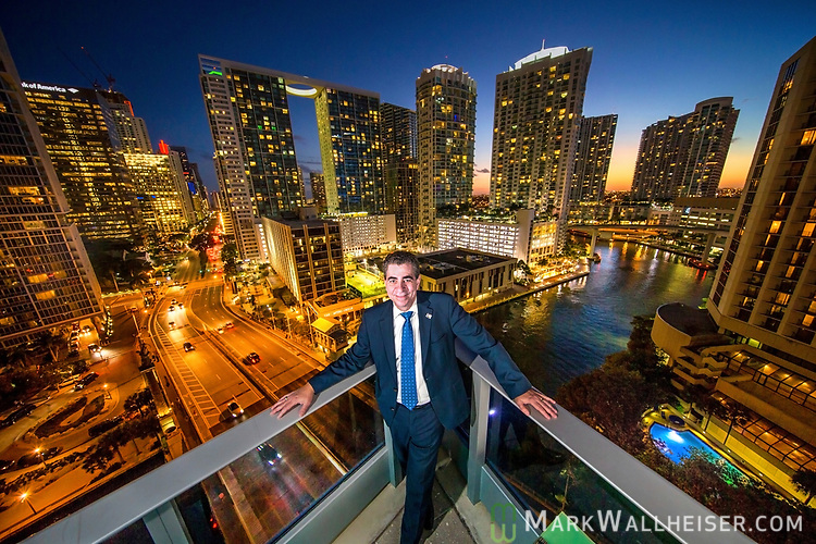 Florida Bar president Michael Higer overlooking Bickell Street and the Miami River in downtown Miami, Florida.