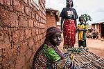 """CAR, Yelloke: a peul girl in front of her house in Yelloke. After the crisis in CAR, the anti-balaka of Yelloke city have decided to build a village where the muslim minority, the Peuls, can live and be protected by the UN.  23th April 2016. <br /> <br /> RCA, Yelloke: une jeune fille peul devant sa maison à Yelloke. Après la crise de Centrafrique, les anti-balaka ont décid"""" de construire un village pour la minorité musulmane, les peuls, où ils peuvent vivre et être protégés par l'UN.  23 avril 2016."""