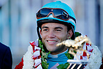 ARLINGTON HEIGHTS, IL - AUGUST 12: Beach Patrol jockey Joel Rosario smiles in the winner's circle after winning the Arlington Million on Arlington Million Day at Arlington Park on August 12, 2017 in Arlington Heights, Illinois. (Photo by Jon Durr/Eclipse Sportswire/Getty Images)