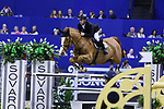 OMAHA, NEBRASKA - MAR 31: Marcus Ehning rides Pret A Tout during the FEI World Cup Jumping Final II at the CenturyLink Center on March 31, 2017 in Omaha, Nebraska. (Photo by Taylor Pence/Eclipse Sportswire/Getty Images)