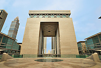 Dubai Financial District.  The Gate Building housing the DIFC, the international finance centre.  Emirates Towers and World Trade Centre visible through arch.  .