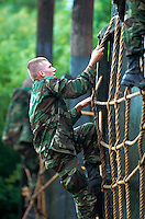 Male female recruits on a training confidence course. San Antonio, Texas.