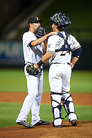 Salt River Rafters pitcher Shane Carle (37), of the Colorado Rockies organization, talks with catcher Jacob Nottingham (24), of the Milwaukee Brewers system, during a game against the Peoria Javelinas on October 11, 2016 at Salt River Fields at Talking Stick in Scottsdale, Arizona.  The game ended in a 7-7 tie after eleven innings.  (Mike Janes/Four Seam Images)