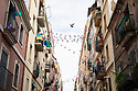 Spain - Barcelona - Two neighbours living in the Barceloneta talk to eachother from their respective balconies. The neighborhood was constructed during the 18th century for the residents of the Ribera neighborhood who had been displaced by the construction of the Ciutadella of Barcelona.