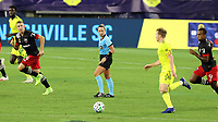 NASHVILLE, TN - SEPTEMBER 23: Referee Tori Penso watches Dax McCarty #6 of Nashville SC play the ball during a game between D.C. United and Nashville SC at Nissan Stadium on September 23, 2020 in Nashville, Tennessee.