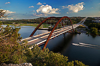 360 Bridge, officially known as the Pennybacker Bridge, is one of the most spectacular sites in Austin. The bridge is 1,150 feet (351 meters) long and spans Lake Austin to connect north and south Loop 360 highway. This arch bridge hovers at 100 feet (30 meters) above the water with a single span of 600 feet (183 meters). The Pennybacker Bridge was opened in 1982.