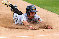Quad Cities River Bandits outfielder Jonathan Lacroix (13) slides into third base during a Midwest League game against the Kane County Cougars on July 1, 2018 at Northwestern Medicine Field in Geneva, Illinois. Quad Cities defeated Kane County 3-2. (Brad Krause/Four Seam Images)