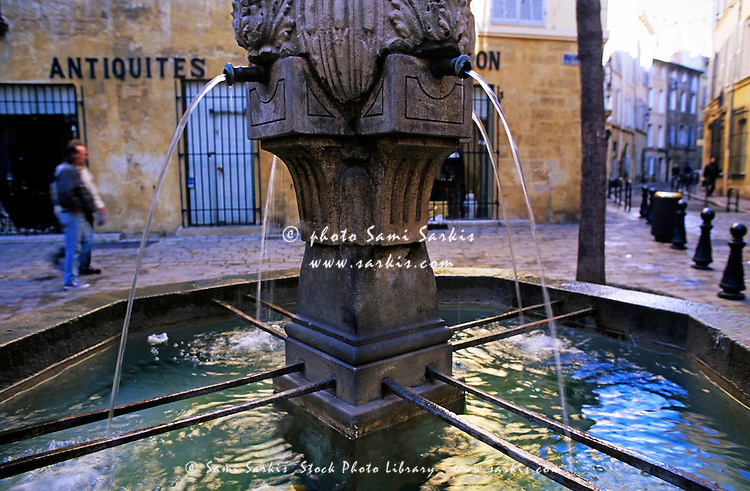 Water fountain on the Place des Trois Ormeaux, Aix-en-Provence, France.