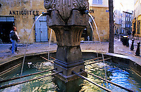 Water fountain on the Place des Trois Ormeaux, Aix-en-Provence, France.