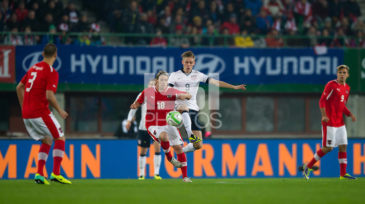 VIENNA, Austria - November 19, 2013: Aron Johannsson and Austria's Christoph Leitgeb during a 0-1 loss to host Austria during the international friendly match between Austria and the USA at Ernst-Happel-Stadium.